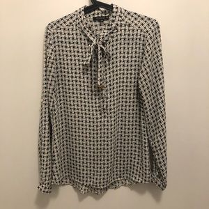 Black and white partial button up blouse